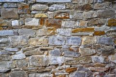 Vägg för sten- eller sandstenbakgrund royaltyfria foton