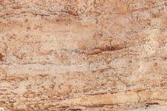 Vägg för textur för röd och gul klippa för stenigt berg naturlig arkivfoton