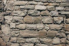 Vägg från en kanstött sten Arkivfoton