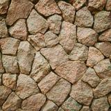 Vägg från texturerade stenar royaltyfria foton