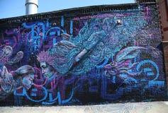 Vägg- konst på Wellington Court i det Astoria avsnittet i Queens Arkivfoton