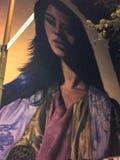 Vägg- målning av kvinnan med en tvetydig blick royaltyfria bilder