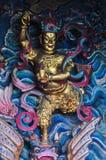 Vägg med guld- skulptur Royaltyfri Bild