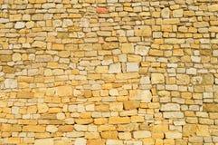 Vägg med tegelstenar av franska stenar Royaltyfri Foto