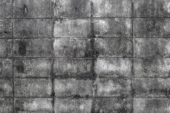 Väggen av dekorativa tegelstenar för konkreta tegelplattor textural sammansättning, arkivfoton