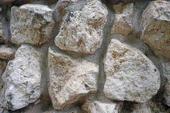 Väggen av naturliga stenar av olika format royaltyfri fotografi
