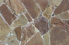 Väggen består av fragment av inpassade stenar tillsammans Fotografering för Bildbyråer