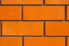Väggen gjorde ‹för †av keramiska tegelstenar Arkivbild
