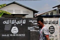 Väggmålning av ISIS-flaggan i Indonesien Royaltyfria Bilder