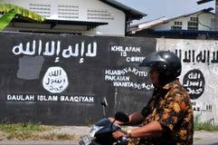 Väggmålning av ISIS-flaggan i Indonesien Arkivfoto