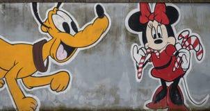 Väggmålning med den Pluto- och Minnie musen Arkivbild