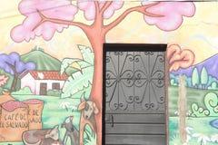 Väggmålning på ett hus på Ataco i El Salvador Arkivbild