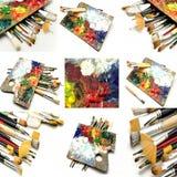 Väggmålningen av borstar, och olja målar paletter arkivfoto