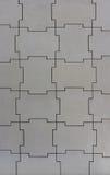 Väggstruktur av jigsawstycken Royaltyfri Foto