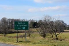 Vägmärke för Carlisle Fairgrounds Exit av mellanstatliga 81 som är södra i Pennsylvania Royaltyfria Bilder