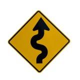 Vägmärke som indikerar kurvor framåt Arkivfoto