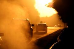 vägsolnedgång Fotografering för Bildbyråer