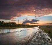 vägsolnedgång till Royaltyfri Bild