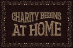 Välgörenhet börjar hemma Engelsk ordstäv Royaltyfri Fotografi
