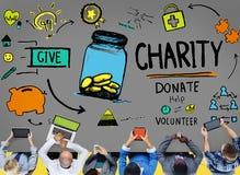 Välgörenhet donerar hjälp ger besparingen som delar servicevolontären Concep Arkivbilder