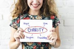 Välgörenhet ger begrepp för hoppinspirationkamratskap royaltyfri foto