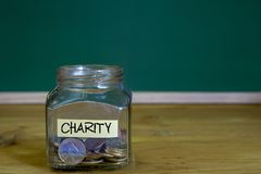Välgörenhetpengarkrus finansiellt begrepp Arkivfoton