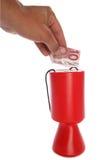 välgörenhetutklipp som donerar euros, man tio till Arkivfoto