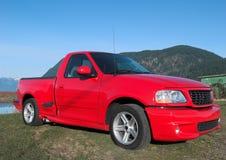 välj upp den röda lastbilen Royaltyfria Foton