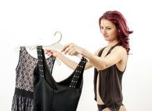 Välja en klänning Arkivfoto