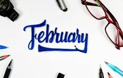 Välkomna Februari firar vi Februari, oss älskar Februari Arkivfoton