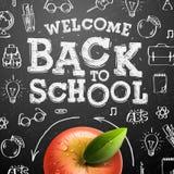Välkomna tillbaka till skolabakgrund med det röda äpplet Arkivbild