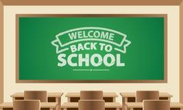 Välkomna tillbaka till symbolet för skolatext på den svart tavlan med klassrumet Arkivfoto