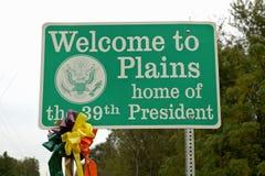 välkomnande för ï¿ ½ till tecknet för Plainsï ¿ ½, hemmet av den 39th presidenten, Jimmy Carter, slättar, Georgia Arkivfoto