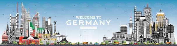 Välkomnande till Tysklandhorisont med Gray Buildings och blå himmel