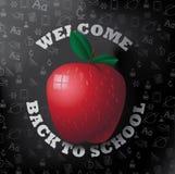 Välkomnande tillbaka till skolaäpplet på svart tavla Fotografering för Bildbyråer
