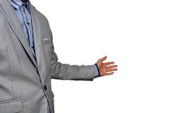 Välkomnandet för showen för affärsmannen eller inviterar gest på vit bakgrund royaltyfri foto