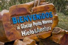 Välkomnandet undertecknar i det Perito Moreno affärsföretaget arkivfoton