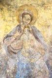 Välsignade jungfruliga Mary med behandla som ett barn Jesus Arkivfoto