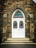 Välvd kyrklig dörr Royaltyfria Bilder