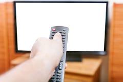 Vänd på TV med skärmen för snittet ut vid fjärrkontroll Arkivfoto