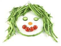 vänd roliga grönsaker mot Arkivbild