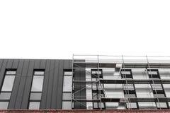 Vända mot arbeten, installation av utrustning, material till byggnadsställning Konstruktion och konstruktionsservice begrepp, bak royaltyfria bilder