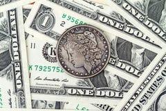 Vända om 1 US dollar och pappers- pengar Royaltyfri Fotografi