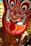 vänder theyyam mot Royaltyfri Foto
