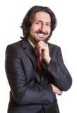 Vänlig turkisk affärsman som ser kameran Royaltyfri Fotografi