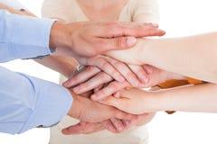 Vänner med deras händer som tillsammans staplas Arkivfoto