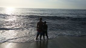 Vänner på stranden Arkivfoto