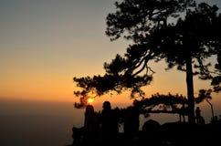 Väntande på solnedgång arkivfoto