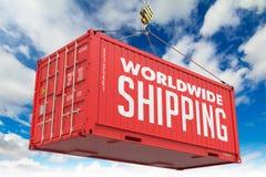 Värld - bred sändnings - röd hängande lastbehållare Arkivbild