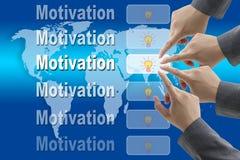 värld för motivationlagteknologi Arkivfoto